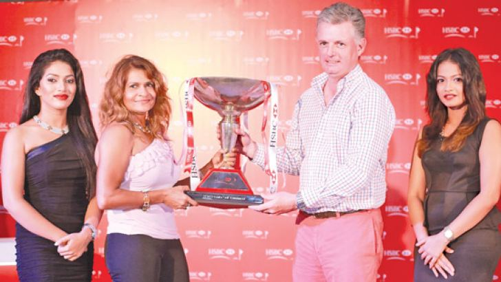 Sharon Hall, overall winner of the HSBC Premier Golf Tournament 2015, being awarded the Premier Challenge Trophy by Patrick Gallagher, CEO of HSBC Sri Lanka and Maldives