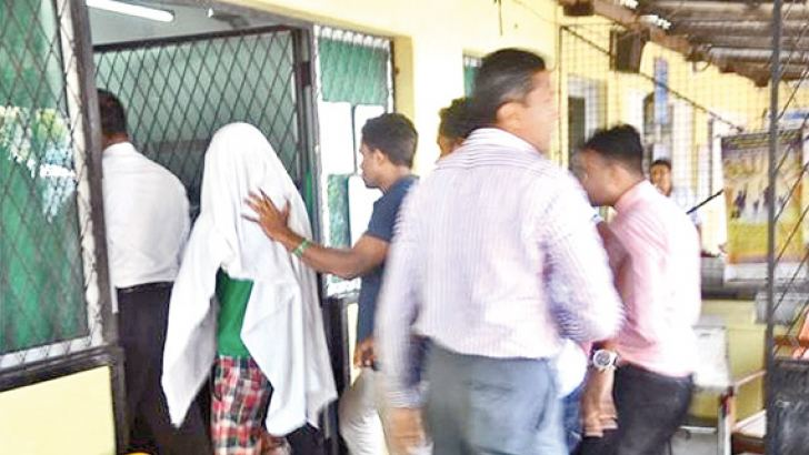 Dinesh being brought to the Negombo hospital