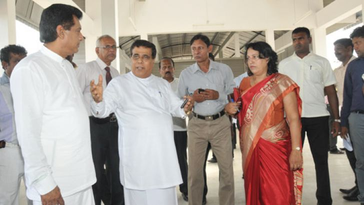 Transport Minister Nimal Siripala de Silva inspecting the construction site of the new bus terminal being built in Vavuniya.