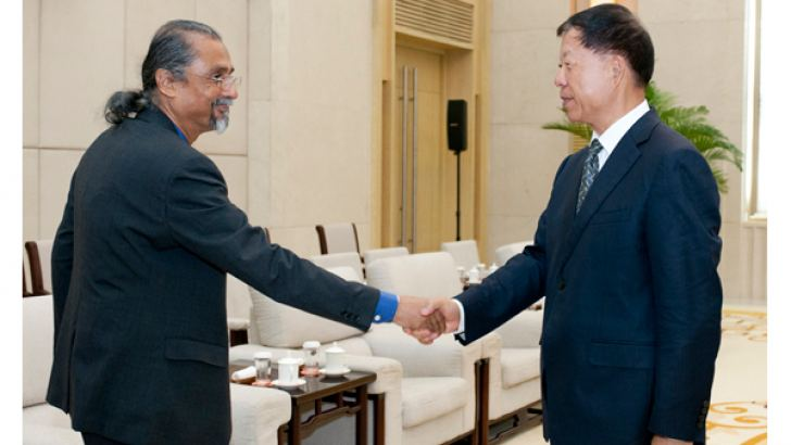 Additional Secretary to the Prime Minister Saman Athaudahetti with Chinese Vice Minister of the International Department of the Communist Party meeting Chen Fengxiang.