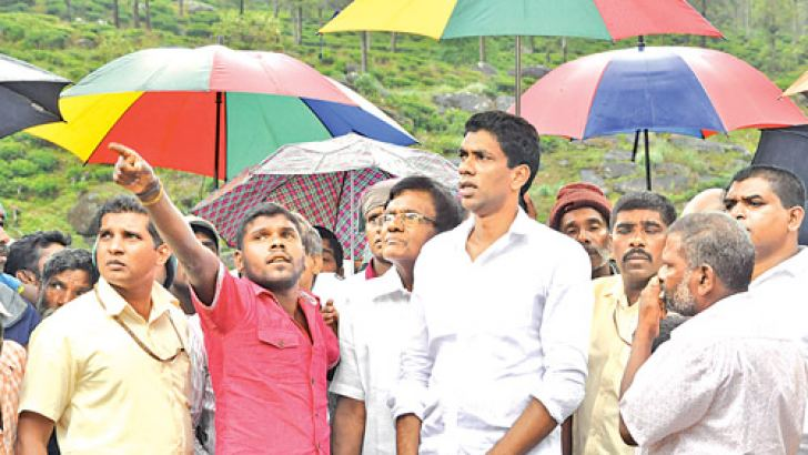 Minister P. Digambaram at the landslide site in Kotmale during an inspection tour.