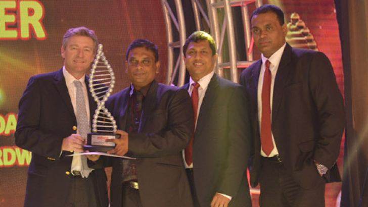Philippe Richart, CEO, Holcim Lanka with the Regional award Distributor of the year winners.