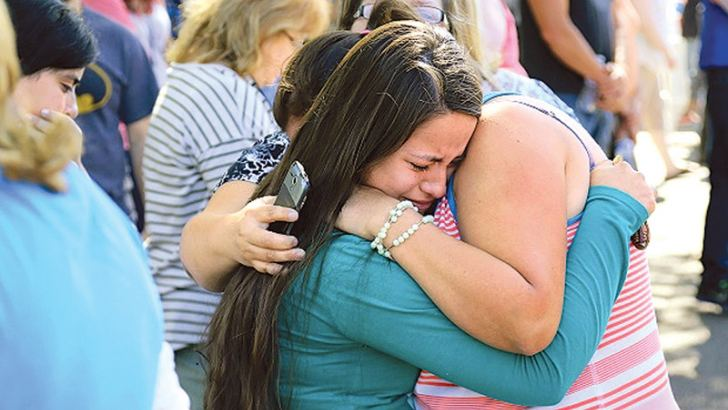 Jessica Vazquez,(L), hugs her aunt Leticia Acaraz as they await word on Acarazs daughter at the local fairgrounds after a shooting at Umpqua Community College in Roseburg, Oregon on Thursday.