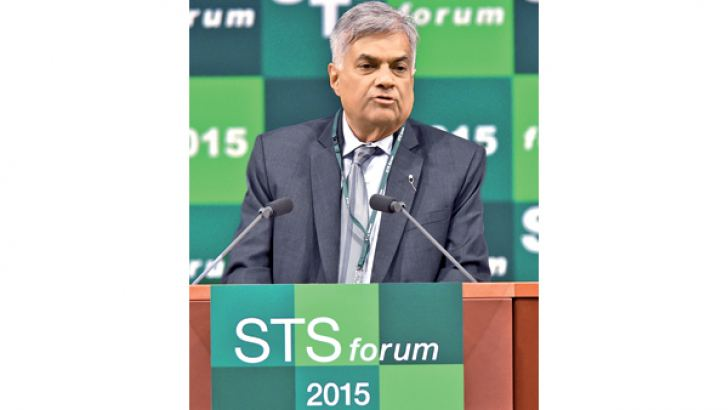 Prime Minister Ranil Wickremesinghe delivers the opening remarks at the opening session of the Science and Technology in Society   forum in Kyoto, Japan yesterday. AFP