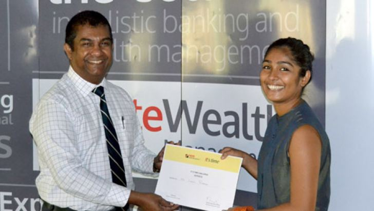 "Lonali Rodrigo, first of three winners for the inaugural NDB Wealth ""It's Time"" Challenge, with NDB Wealth CEO, Prabodha Samarasekera."