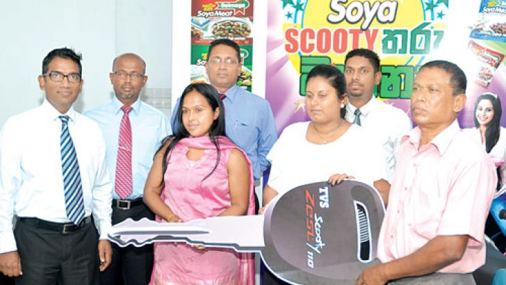 The Scooty Tharu winners with Delmege officials Picture by Vipula Amarasinghe