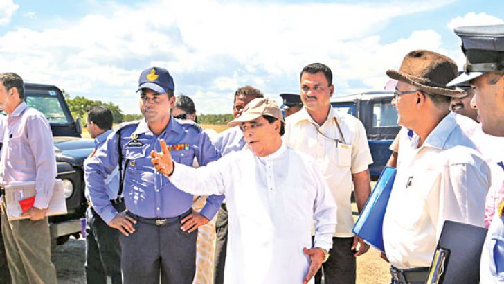 Transport Minister Nimal Siripala de Silva is seen talking to officials during inspection tour of the Batticaloa domestic airport yesterday
