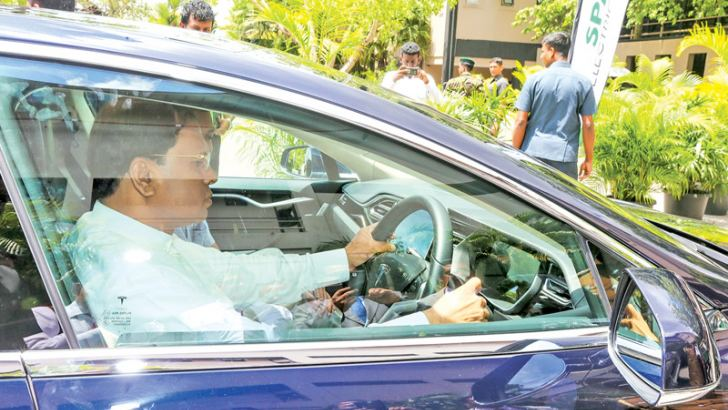 President Maithripala Sirisena who inaugurated the 9th annual summit of the Institute of Environmental Professionals of Sri Lanka at Waters Edge Hotel, Battaramulla is seen driving an environmentally friendly electric car imported into the country. Picture by Sudath Silva