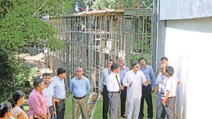 Higher Education State Minister Mohan Lal Grero participates in an observation tour of the on-going hostel construction project at the Moratuwa University