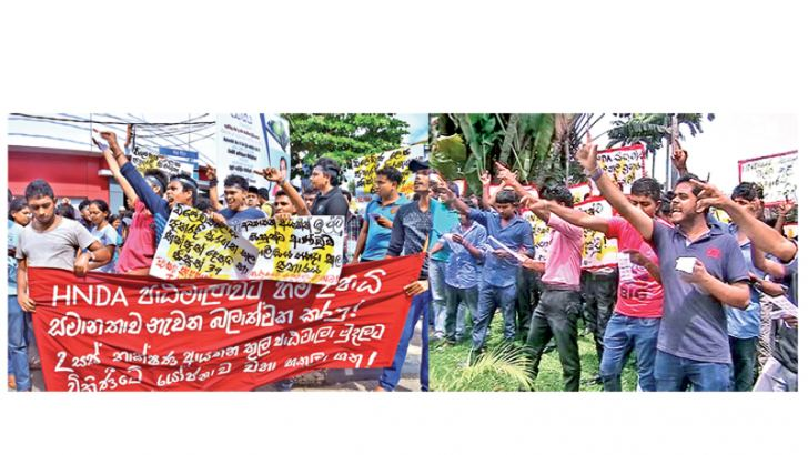 Students of a number of universities yesterday staged protests opposing the Police assault on the HNDA students in Colombo on Thursday. Pictures show students of the Sri Jayawardenapura, Peradeniya and Ruhuna Universities protesting against the Police attack.  Pictures by Sulochana Gamage, Asela Kuruluwansa and Priyan de Silva