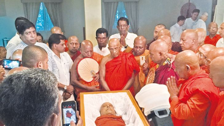 The remains of Most Ven. Maduluwawe Sobitha Thera was received by the Maha Sanga at the Sri Lankan Embassy in Singapore. Finance Minister                            Ravi  Karunanayake was present representing the Sri Lankan government.  (Below) The remains of Most Ven. Maduluwawe Sobitha Thera which arrived last night being taken from the BIA, Katunayake. Picture by Airport corr. Kumarasiri Prasad