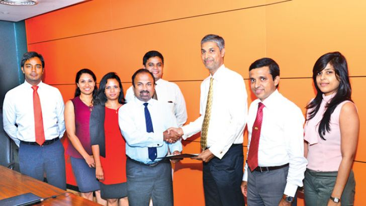 Hemas Manufacturing Managing Director Roy Joseph exchanges the signed agreement with  SLINTEC Chief Executive Officer Harin de Silva Wijeyeratne.Director R&D, Dimuthu Jayasinghe, Director Innovation and New  Business Dr. Himesh Fernando, Head of Corporate Finance Vathsala  Wijekoon, Legal Consultant Maheshi Pieries.  Science Team Leader Prof.  Nalin de Silva and Business Development Team's Rashmi Wijekoon look on.