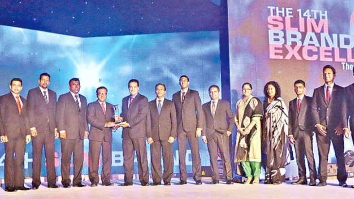 The Ceylinco Life team receives the Silver for Service Brand of the Year at the SLIM Brand Excellence Awards 2015