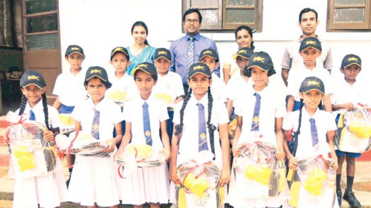 Grade Five Scholarship high fliers with BOC Wanduramba Branch Manager Supun K.Liyanage and his staff members
