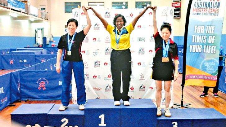 Former national women's table tennis champion Tamara Hewage (centre) celebrates her win in the 50-64 singles category where she won two golds at the Australian Masters championships beating two Chinese opponents in the semi-finals and the final. Tamara also won a silver in the team event and a bronze in the mixed doubles.