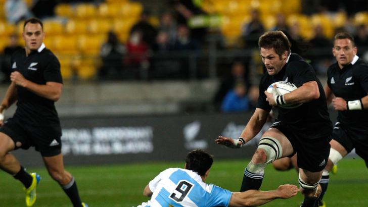 New Zealands captain Richie McCaw (R) is tackled by Argentinas Nicolas Vergallo during the New Zealand vs Argentina Test match.  AFP