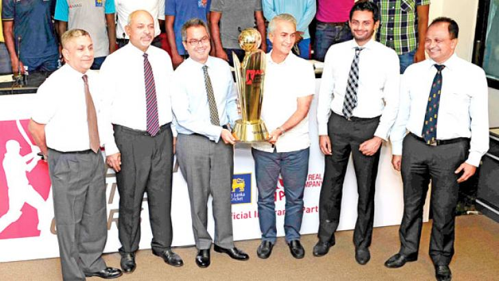 AIA Insurance Lanka PLC CEO Shah Rouf  and Sri Lanka Cricket interim committee chairman Sidath Wettimuny display the AIA Insurance Lanka trophy that will be handed to the winners of the AIA Premier limited-over cricket tournament at a press conference held at SLC headquarters yesterday. Tournament committee chairman Ravi de Silva, SLC CEO Ashley De Silva, SLC secretary Prakash Shafter and Head of Marketing-AIA Insurance Suren Perera are also present. picture by Rukmal Gamage
