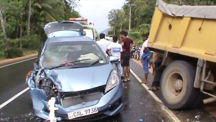 The car which collided with the tipper lorry.
