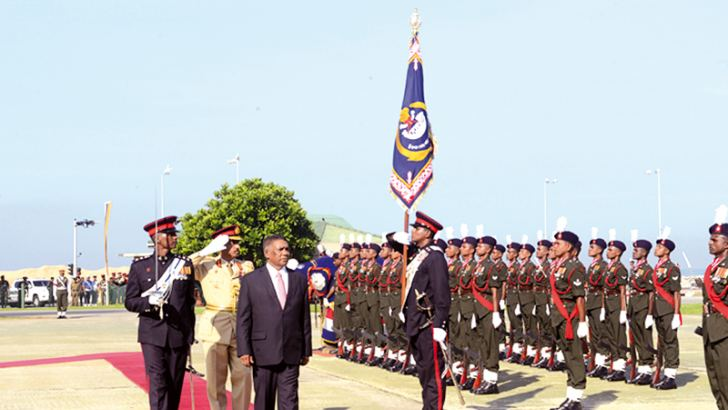Defence  Ministry Secretary Karunasena Hettiarachchi inspects the Guard of  Honour   during the first formal courtesy visit to the Army Headquarters  on Friday. - Army Media Unit