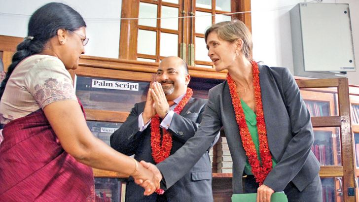 United States Ambassador to the United Nations Samantha Power who visited the Jaffna Public Library yesterday, is seen greeting Chief Librarian Suganthy Sudhasivamoorthy. US Ambassador Atul Keshap is also in picture. Picture by Rukmal Gamage