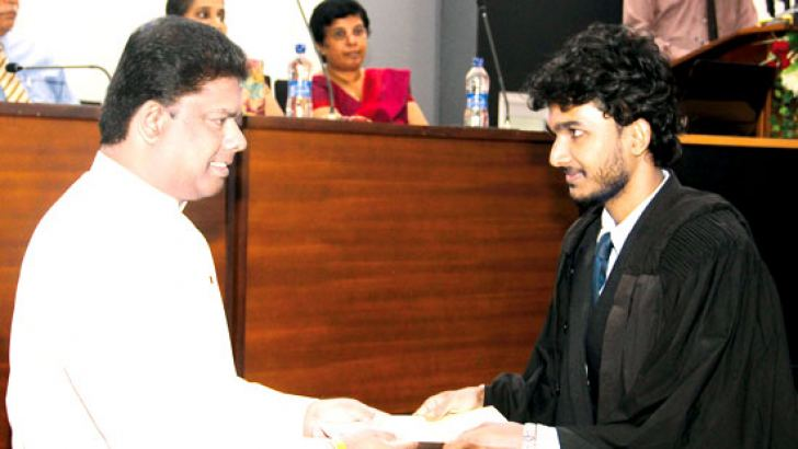 Parliamentary Reforms and Media Minister Gayantha Karunatilleke presents a certificate to a successful student