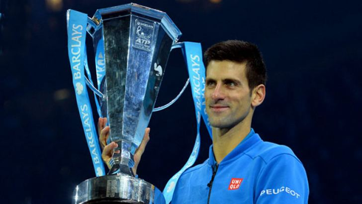 Serbia's Novak Djokovic poses with the ATP trophy after winning the men's singles final match against Switzerland's Roger Federer on day eight of the ATP World Tour Finals tennis tournament in London on November 22, 2015. AFP