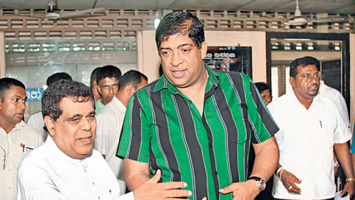 Finance Minister Ravi Karunanayake and Transport Minister Nimal Siripala de Silva participate in an observation tour of the Mattakkuliya SLTB depot