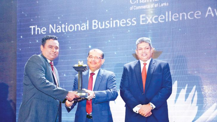 Dr. Mohan Pathirana CEO and Executive Director of ICBT Campus receiving the Gold Award