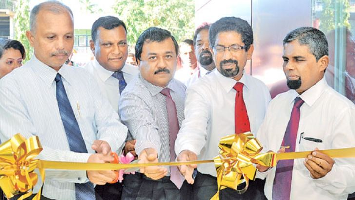 People's Bank CEO and General Manager N. Vasantha Kumar opening the Kekirawa Branch