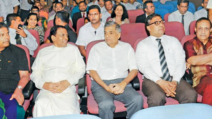 President Maithripala Sirisena, Prime Minister Ranil Wickremesinghe, Speaker Karu Jayasuriya, Media and Parliamentary Reforms Minister Gayantha Karunatilake with several other parliamentarians enjoying Suhada Koka, the latest comedy film directed by Giriraj Kaushalya at the National Film Corporation Film Hall in Colombo yesterday. The movie produced by Ravidra Guruge is based on a story about a politician. NFC Chairman Deepal Chandraratne is also in the picture. Picture by Wimal Karunatilake