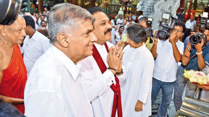 Prime Minister Ranil Wickremesinghe and former President Mahinda Rajapaksa arrived at the Gangaramaya to extend their wishes to Chief Incumbent of  Hunupitiya Gangaramaya Ven.Galaboda Gnanissara Thera.
