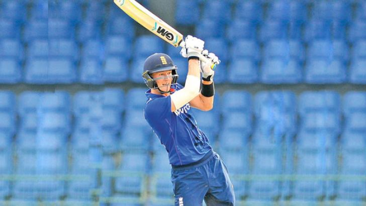 George Bartlett who top scored for England makes a drive in the under 19 tri-nation match against India at the R Premadasa Stadium yesterday. Pic by Samantha Weerasiri