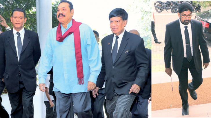 Former President Mahinda Rajapaksa and former Media Minister Keheliya Rambukwella arriving at the Presidential Commission of Inquiry to Investigate and Inquire into Serious Acts of Fraud, Corruption and Abuse of Power, State Resources and Privileges yesterday. Pictures by Saman Sri Wedage