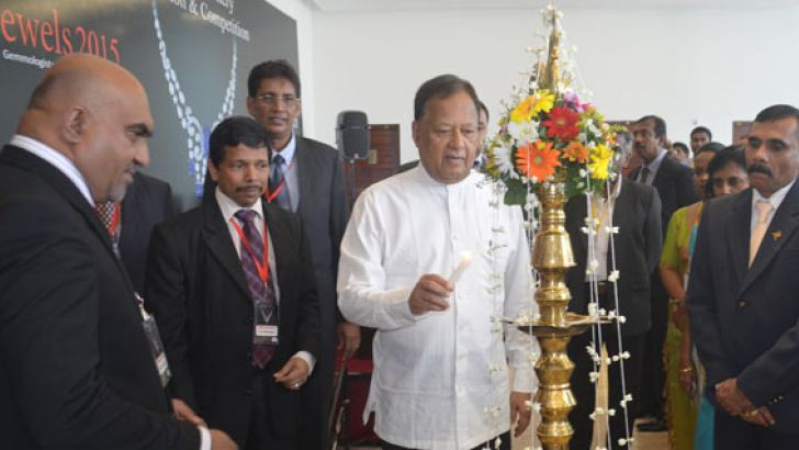 Special Assignments Minister  Dr. Sarath Amunugama lights the oil lamp to inaugurate Jewels 2015
