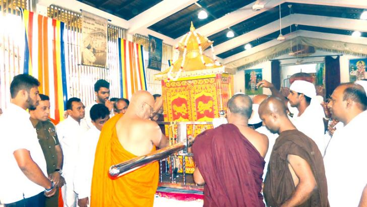 The Image of Deity Sumana Saman being placed in the Palanquin to be taken to Sri Pada Maluwa in a procession. Picture by N P Rajadorai, Ratnapura Special Corr