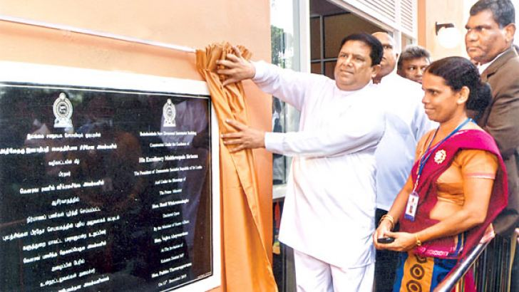 Home Affairs Minister Vajira Abeywardena unveils a plaque outside the newly built Divisional Secretariat building in the Bulathsinhala electorate, December 13.