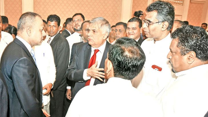 Prime Minister Ranil Wickremesinghe with Ministers Dr. Rajitha Senaratne, Patali Champika and Sagala Ratnayaka and others who gathered at Temple Trees  yesterday to extend New Year greetings to  him. Picture by Rukmal Gamage