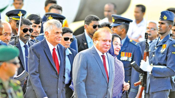 Pakistani Prime Minister Nawaz Sharif and his wife Kalsoom Nawaz Sharif who arrived in Sri Lankan yesterday were received by Prime Minister Ranil Wickremesinghe at the Bandaranaike International Airport in Katunayake yesterday. Picture by Sulochana Gamage