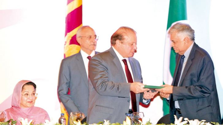 The book titled Majestic Pakistan was presented  to Prime Minister Ranil Wickremesinghe by Pakistani Prime Minister Nawaz Sharif at the Grand Ball Room of the Galadari Hotel yesterday. A Pakistan-Sri Lanka Friendship Anthem was also launched in the Sinhala, Urdu and Tamil languages during this ceremony. The anthem was sung by Pakistani and Sri Lankan  children. The launch of the anthem and the book took place during a dinner hosted by the Pakistan High Commission in Colombo. Picture by Sulochana Gamage