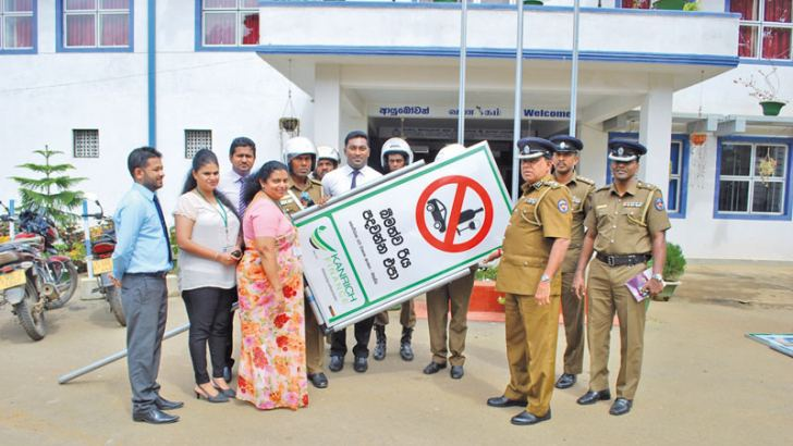 Kanrich Finance donating the Traffic Sign Boards.