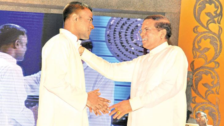 Ex-LTTE combatant Sivaraja Jenivan who was convicted for making an abortive attempt on the life of President Maithripala Sirisena received   Presidential clemency. He was found guilty on the attempted murder charges and sentenced to 10 years Rigorous Imprisonment by Polonnaruwa High Court on July 3, 2015. Picture shows the President greeting him.  Picture by Sudath Malaweera