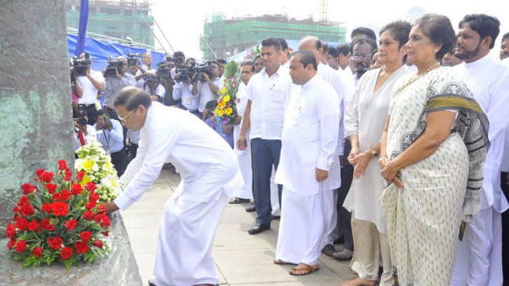 The 117th birth anniversary of former Prime Minister S.W.R.D. Bandaranaike was commemorated at Galle Face yesterday. President Maithripala Sirisena is seen placing floral tributes at the foot of the Bandaranaike statue. Former President Chandrika Bandaranaike Kumaratunga, Sunethra Bandaranaike, ministers and parliamentarians representing the SLFP were also present. Picture by Sudath Malaweera