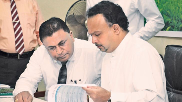 Minister with Tea Small Holding Development Authority and Tea Shakthi Foundation Chairman Wijeratne Devagedara at the event