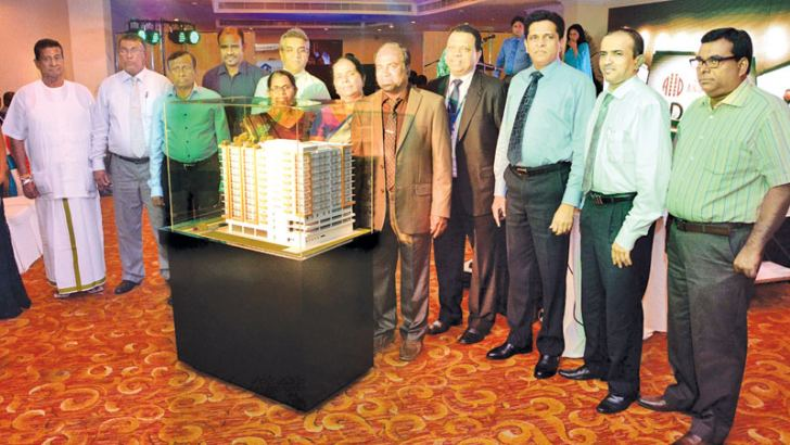 A &D Property Developers (Pvt) Ltd Managing Director P Lionel Ariyaratna with a image of Glorious Residencies' looked on by stakeholders at the launch. Picture by Sarath Pieris