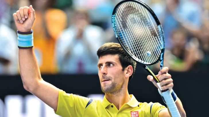 Serbia's Novak Djokovic celebrates after victory  in his men's singles match against South Koreas  Chung Hyeon on day one of the 2016 Australian Open  tennis tournament in Melbourne on January 18. AFP