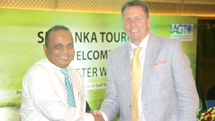 The Global Golf Tourism Organisation President and Chief Executive Peter Waltton who was in Sri Lanka last week congratulating Chandana Amaradasa.