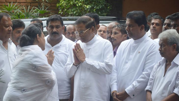 President Maithripala Sirisena paid his respects to Udula Kumarasinghe, the mother of Galle district Parliamentarian Geetha Kumarasinghe at Nawala yesterday. Picture shows Kumarasinghe greeting  the President. Media and Parliamentary Reforms Minister Gayantha Karunathilake is also in the picture. Picture by Bandula Alahakoon