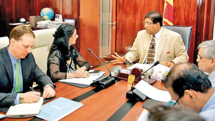 Minister of Finance Ravi Karunanayake meeting the IMF team at the Finance Ministry last Friday.