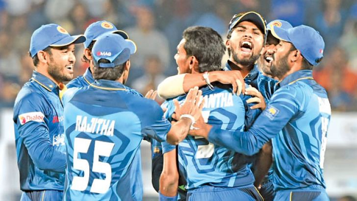 Sri Lankans celebrate another Indian wicket in the first T20I played at Pune which they won by five wickets. AFP