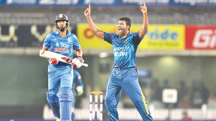 Thisara Perera performs the hat-trick with the dismissal of Yuvraj Singh in the second T20I at Ranchi on Friday.
